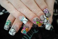 spring inspired nails. all hand drawn nail art, dried flowers, rhinestones