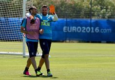 Giorgio Chiellini (L) and Salvatore Sirigu of Italy chat at the end of the training session on June 9, 2016 in Montpellier, France.