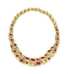 A RUBY, DIAMOND AND GOLD NECKLACE, BY VAN CLEEF & ARPELS  - The front set with a graduated series of oval cabochon rubies, enhanced with circular-cut diamond detail, to the sculpted 18k gold link neckchain, mounted in 18k gold and platinum, 15 ins., with French assay marks and maker's mark  Signed Van Cleef & Arpels, no. 14687