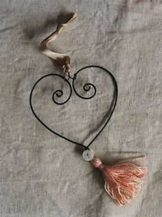 This is a romantic heart ornament made by me out of old fashioned black wire, and decorated with a hand dyed silk tassel and antique pearly buttons. Valentine Crafts, Valentines, Twisted Metal, Heart Ornament, Handmade Wire, Wire Crafts, Wire Art, How To Make Ornaments, String Art