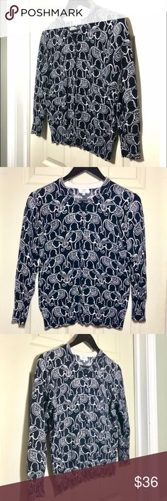 Crown & Ivy elephant cardigan Size M Navy with white elephant pattern cardigan. Excellent condition. Many buttons. Ribbed at sleeve ends and bottom. Crown & Ivy size M. crown & ivy Sweaters Cardigans