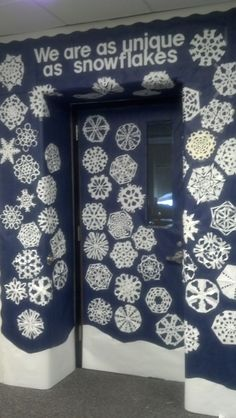 Celebrating diversity in English class...  students cut their own snowflakes. Their pictures, cut round to fit, will go on the center of their snowflake.
