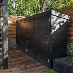 Family garden design in Wandsworth, designed by Philip Wells, Design Box Architecture and constructed by The Garden Builders Backyard Storage, Garden Storage Shed, Backyard Sheds, Outdoor Sheds, Shed Design, Garden Design, Outdoor Cupboard, Modern Shed, Patio Planters