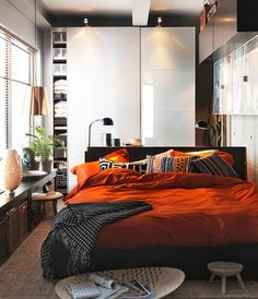 <3 the colors, tribal pillows, & the modern feel of the room. :)
