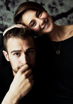 """Theo James and Shailene Woodley pose for a photograph as they promote the movie """"Divergent,"""" in Toronto on Thursday, March 6, 2014."""