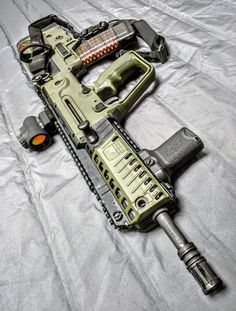 IWI Tavor Olive Drab Green, outfitted with Trijicon MRO sight. Airsoft Guns, Weapons Guns, Guns And Ammo, Shotguns, Armas Airsoft, Ar15, Aigle Animal, Future Weapons, Molon Labe
