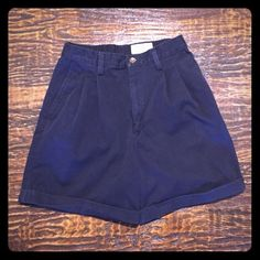 """VINTAGE Eddie Bauer High Waisted Walking Shorts Washed but never worn. Excellent vintage condition. 100% Cotton. Cuffed at hem. Pleats in front. Darts and one pockets with button close in back. Navy Blue. Vintage sizing, so please make sure approximate measurements below work for you.   Approximate Measurements (unstretched):  Waist - 27"""" Lower hips - 40"""" Rise - 13"""" Inseam - 5.75"""" Vintage Shorts"""