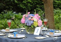 Summer wedding centerpiece, blue hydrangea, pink peonies, pink asters, veronica, green hydrangea. Image by Dani Fine Photography