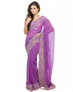 A striking Purple Georgette saree featuring a broad border featuring thread embroidery in Gold & Silver. The broad border makes the saree perfect for an exclusive day/evening event. Compliment the outfit with kundan earrings and a Gold clutch. The saree is complete with fall and finish. #Ootd #Potd #Qotd #Fashion #Shopping #WomenWear #IndianWear #Style #Blogger #Mumbai #Wedding #OutfitOfTheDay