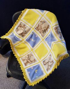 Fleece squares crocheted together to make an adorable baby blanket :)