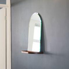 Arc - wall mirror. wood shelf. walnut. oak. bevelled mirror.