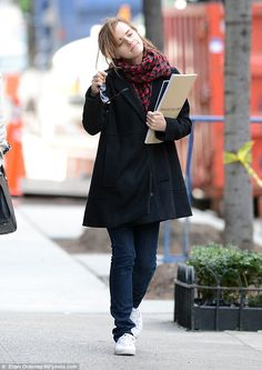 Someone's happy: Make-up free Emma Watson searches for a new home in the Upper West Side of New York