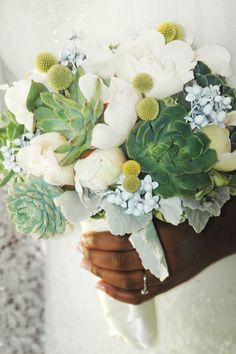 white green and pops of blue bouquet with succulents http://www.weddingchicks.com/2014/02/26/yellow-and-gray-wedding-3/