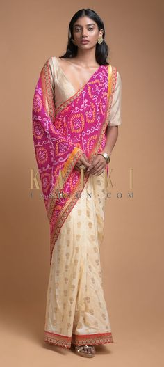Buy Online from the link below. We ship worldwide (Free Shipping over US$100)  Click Anywhere to Tag Ivory Beige And Magenta Half And Half Saree With Bandhani Print And Weaved Floral Buttis Online - Kalki Fashion Ivory beige and magenta half and half saree in silk with weaved floral buttis on the pleats.Enhanced with weaved red border with kundan work