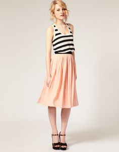 Black and white striped tank, midi peach skirt, and high heel sandals.