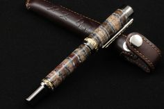 The custom pen is made of a fossil tooth of a Siberian mammoth. The remains of the mammoth were found during geological works near the city of Yakutsk. Is a rare material. Extremely difficult to process. Mammoth Tooth, Custom Pens, Geology, Fossil, Teeth, Gifts, Handmade, Favors, Fossils