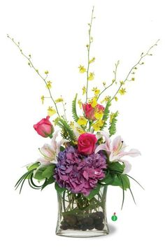 Pretty, distinctive and perfect for a birthday party, baby shower or bridesmaid's celebration. This delicate arrangement of lilies, roses, hydrangea and orchids assembled on a bed of river rocks will