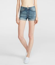 """Want instant trendsetting style? Just pair our High-Waisted Medium Wash Cuffed Denim Shorty Shorts with any tank or tee, and you've got it! Crisscross stitching on the pockets and faded details add to their seriously cool vibe.<br><br>Relaxed fit. Approx. inseam: 2.5""""; Rise: 10""""<br>Style: 2531. Imported.<br><br>99% cotton, 1% spandex.<br>Machine wash/dry.<br><br>Model height: 5'10"""" 