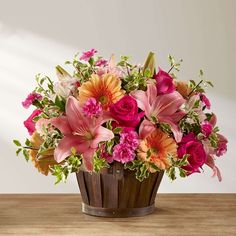Send the gift of Spring flowers with the Spring Garden Basket from Kremp Florist. This bouquet is filled with pink, peach and orange fresh flowers. Gerbera Daisy Bouquet, Gerbera Flower, Pink Carnations, Fake Flower Arrangements, Fake Flowers, Artificial Flowers, Beautiful Flowers, Flower Shop Decor, Garden Basket