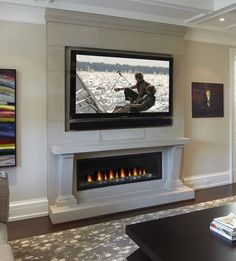 Efficient living room decoration giving exotic combination of gas burning fireplace and TV wall Image 22 - SHAIROOM. Above Fireplace Ideas, Fireplace Tv Wall, Basement Fireplace, Linear Fireplace, Small Fireplace, Faux Fireplace, Fireplace Remodel, Living Room With Fireplace, Fireplace Surrounds