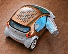 Mini glowing electric car... I want one! (but maybe in green)