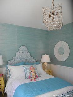 Beautiful girl's bedroom with Phillip Jeffries Bermuda Hemp Turquoise Grasscloth Wallpaper, blue upholstered bed, ocean blue blanket