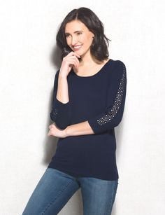 We love classic styles that just have a hint of something extra, like this lace-sleeve pullover. Pair this femme sweater with your go-to denim fit and complete your look with boots or flats.  Imported.
