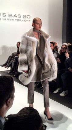 Beautiful cooler taupe tones. Love the contrast of the volume of the coat and the fitted clothing