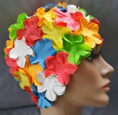 1960s - 1970s rubber swimming cap with fluttering flowers in size medium. True vintage, clean and ready to use or wear in the next beach fashion show.