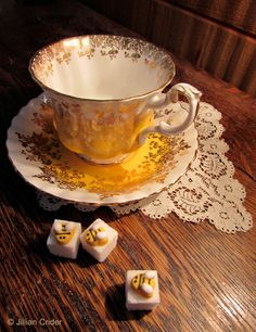 Some of my favorite things. Tea parties. Don't just serve sugar. Dress up some sugar cubes - little edible embellishments are available in craft stores, WalMart and more. Attach with a small dab of icing. Have fun! Photo: Jillian Crider