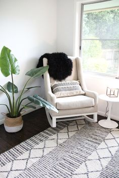 Neutral boys nursery and rocking chair by Bright Kids Interiors