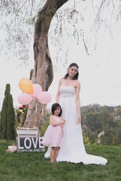 How adorable is the bride's daughter?! Wedding Dress by Ju.Lee Collection juleechic.com | Photo by Alyica Creative | Set Design by Your Vintage Affair Wedding & Event Rentals | Coordination by Blissful 2 Be #wedding #weddingdress #bridalgown #bridaldress #bridal #dress #juleechic #bride #bridetobe #weddingplanning