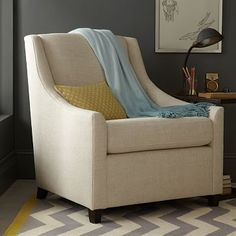 Sweep Armchair #westelm Simple, sloped arms make this feel much more traditional.  Several fabric and color options to choose form.