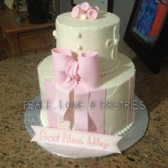 Dedication cake. Pink fondant bow, swirl roses, and stripes.  By: Peace, Love & Pastries