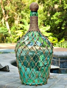 If you love beachy decor you've probably purchased your fair share of netted bottles. Save some money and make your own using jute twine and wine bottles. wine bottle ideas diy crafts creative Bottoms Up! Turn Your Empty Wine Bottles Into Works of Art Empty Wine Bottles, Liquor Bottles, Bottles And Jars, Glass Bottles, Twine Wine Bottles, Glass Bottle Crafts, Diy Bottle, Bottle Art, Wine Craft