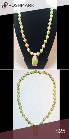 """Handmade Recycle Paper Pendant and Bead Necklace Handmade pendants and bead necklace from recycled paper. Accented with light green transparent glass spacer beads.  The paper pendant and beads were glazed to protect them.  They are as durable as plastic.  New without tags.  The necklace measures 20"""" around but was strung on a stretchy string to fit over the head.  The pendant hangs down 1-1/4"""", is 3/4"""" wide and 1/2"""" thick.  Please contact me if you have any questions. Handmade Jewelry…"""
