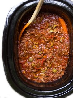 Slow Cooker Ropa Vieja: a slow cooker recipe for Cuba's famously delicious shredded beef stew with peppers.  #Cuban #beef #stew