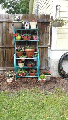 Broken down bakers rack repurposed for the yard :-) adorable!