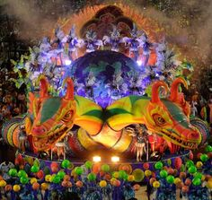 Performers from the Unidos de Vila Isabel samba school parade on a float during the second night of carnival celebrations at the Sambadrome in Rio de Janeiro