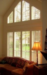 Angled Window Treatment For My Living Room Shutters Wall Shelves