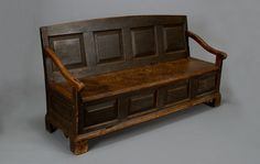 18th Century Setttle Bed.  A settle bed could be converted into a settee.  It was often used as a guest bed.