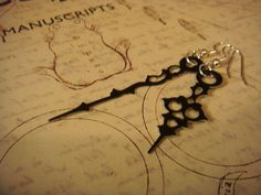 Steampunk Earrings - Small Black Victorian Clock Hand Earrings. $16.00, via Etsy.