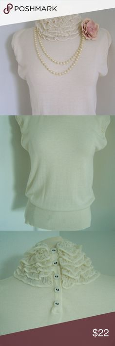 DikTons Barcelona size 6 Ivory ruffle neck Very feminine Diktons Barcelona top in ivory. Composed of 30% Extrafine Merino Wool 30% Viscose and 40 % Polyamide Neck back feature snap closure feature. Size 38 is US size 6-8 or Medium   Smoke free home Pearl necklace and rose NOT included in purchase. DikTons Barcelona Tops