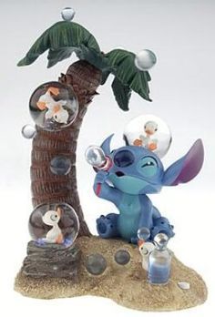 Stitch under palmtree with ducklings four mini snowglobes