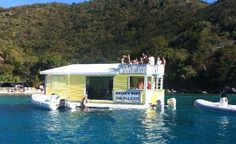 Angel's Rest Day Tours - Floating swim-up BAR/Restaurant in Coral Bay/St. John.  Great reviews.  Drinks $5 each.  Call to see where it'll be - (340) 514-6270.