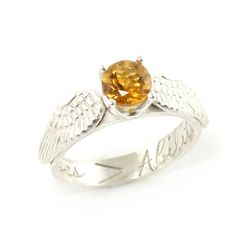 Completely hand crafted and made with your choice of center stone, our Golden Snitch engagement ring is the perfect gift for any Harry Potter fan. You can even