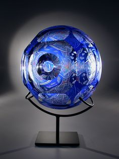 Artist David Schwarz Titled Z.A.O.F. 1-12-10 21.5 x 17 x 11 in. Blown, etched, carved and painted glass sculpture; metal stand