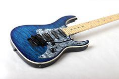 Legator Guitars  the Ninja/Opus Hybrid 350-PRO Guitar in Blue Burst Quilted Maple.