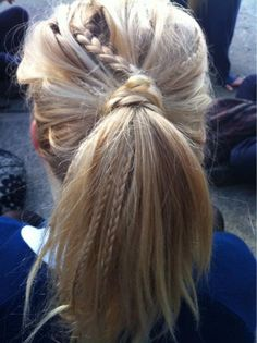 long hair in a messy ponytail with multiple accent braids