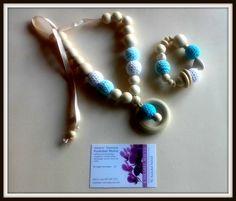 Collares de lactancia naturales. Con bolas de madera sin tratar y bolas de ganchillo 100% algodón. Natural breastfeeding necklace with natural beads and crochet 100 % cotton .